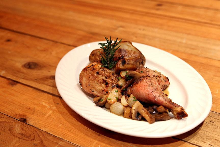 hearty portion of golden-brown tender chicken topped with mushrooms, pearl onions, and roasted garlic