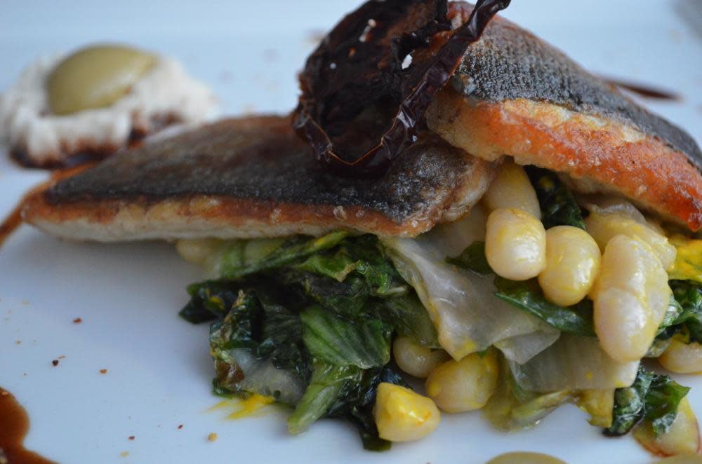 Filet of Bronzino, Green Olive, Cannellini, Escarole, Saffron,  Kumato Agrodolce at The Frog and the Peach