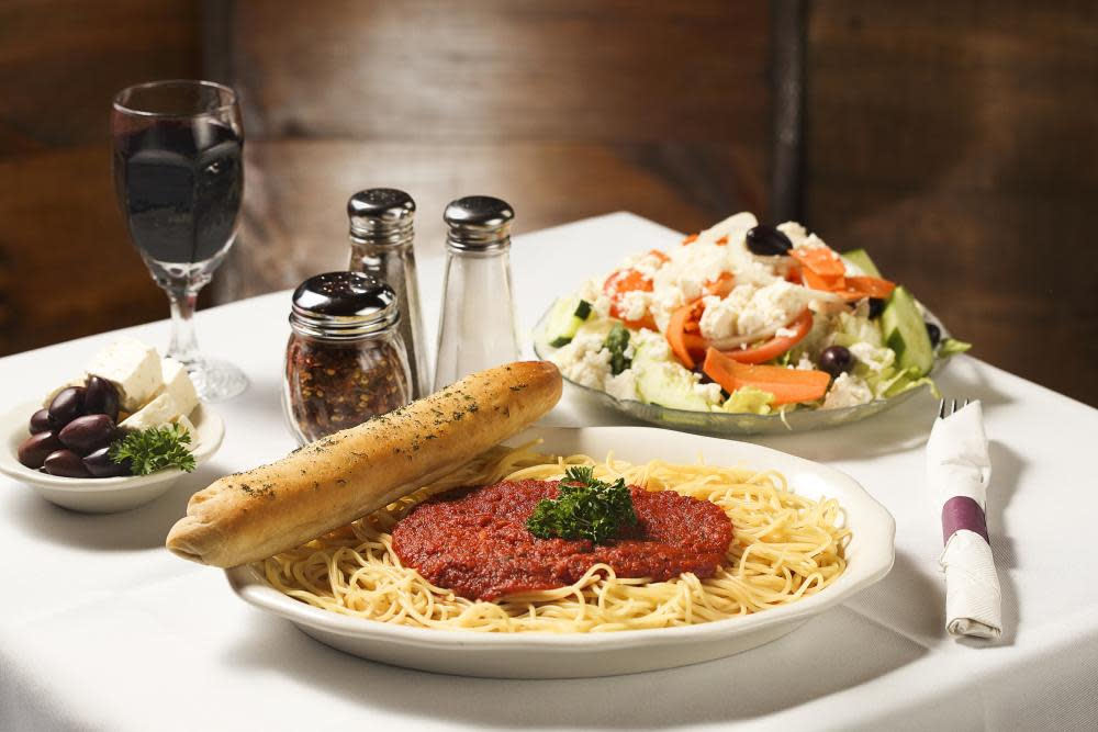 Spaghetti with our home made sauce, served with a dinner Greek salad