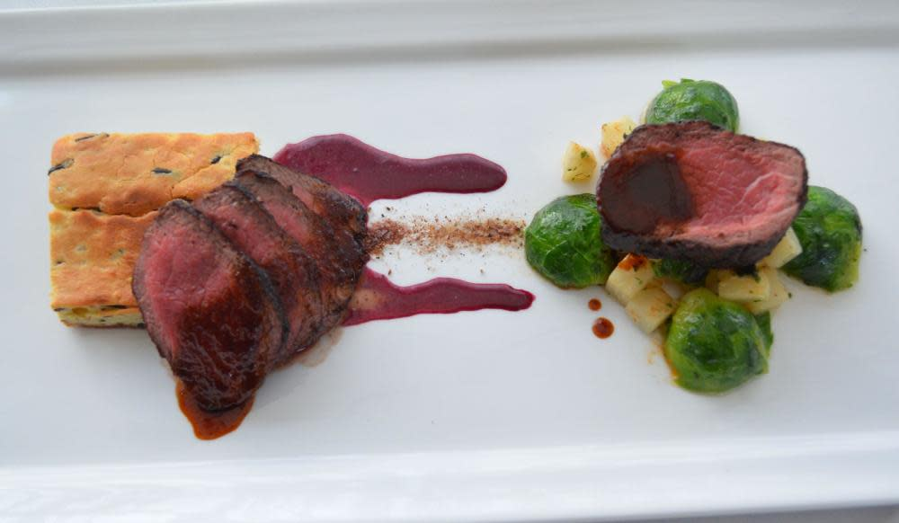 Cervena Venison N.Y. Strip Loin, Wild Rice Genoise, Thyme Glazed Celeriac and  Brussels Sprouts, Huckleberry Sauce, Juniper at The Frog and the Peach