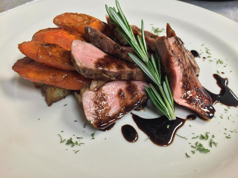 Roasted Duck Breast, roasted local carrots, mashed potatoes, balsamic reduction. at Landmark Café & Creperie