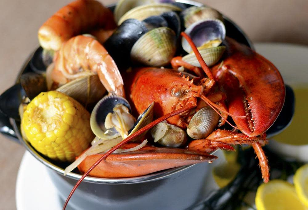 Ed's Lobster Bake includes a 1.25 lb. lobster, clams, mussels, shrimp, andouille, sweet corn & fingerling potatoes for $46. at Ed's Chowder House