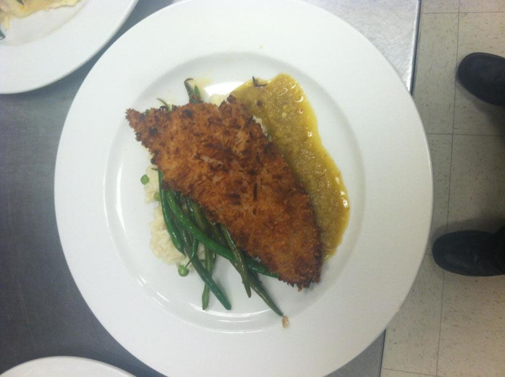 Coconut Fried Local Flounder topped with a Pineapple and Jalapeño Glaze and served with Coconut and Sweet Pea Risotto, and A Vegetable Medley
