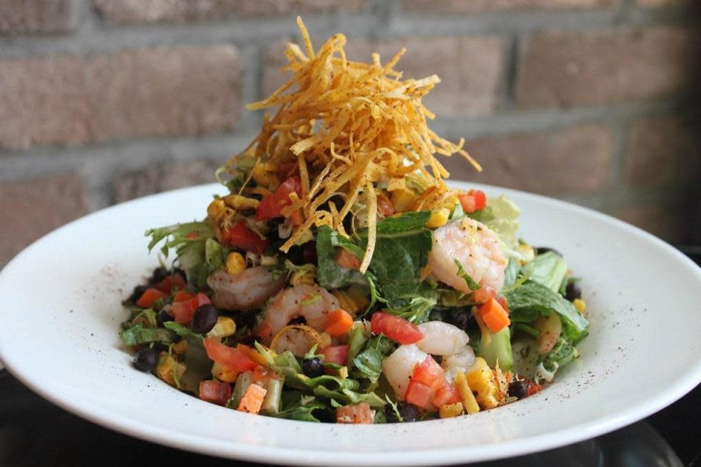 Chili-Poached Shrimp, Mixed Lettuces, Corn, Black Beans, Avocado, Crisp Tortillas and Honey-Lime Dressing.