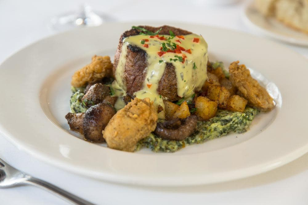 6 oz filet, creamed spinach, Pontalba potatoes, flash fried oysters, sauce Béarnaise at Dickie Brennan's Steakhouse