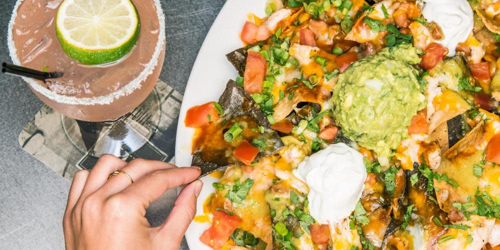 Enjoy over 25 different appetizers including Chicken Nachos while sipping on a sweet Salted Watermelon Margarita.