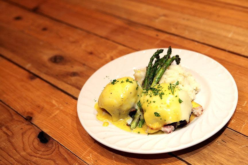 two 4oz tenderloin medallions, blue lump crab, mozzarella served with roasted asparagus and topped with hollandaise sauce