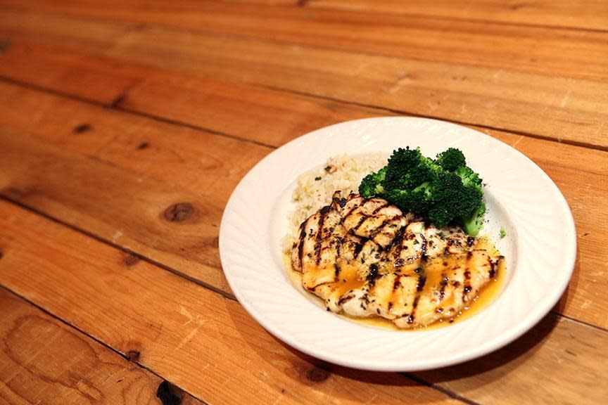 grilled chicken breast served with garlic mashed potatoes, broccoli, and topped with a sweet citrus sauce