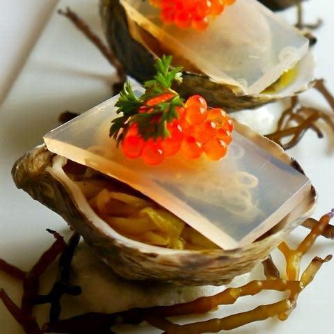 Poached taylor farms shigoku oysters on baby leek salad, lemongrass kanten  sriracha trout roe, ogo mignonette at Chef Mavro