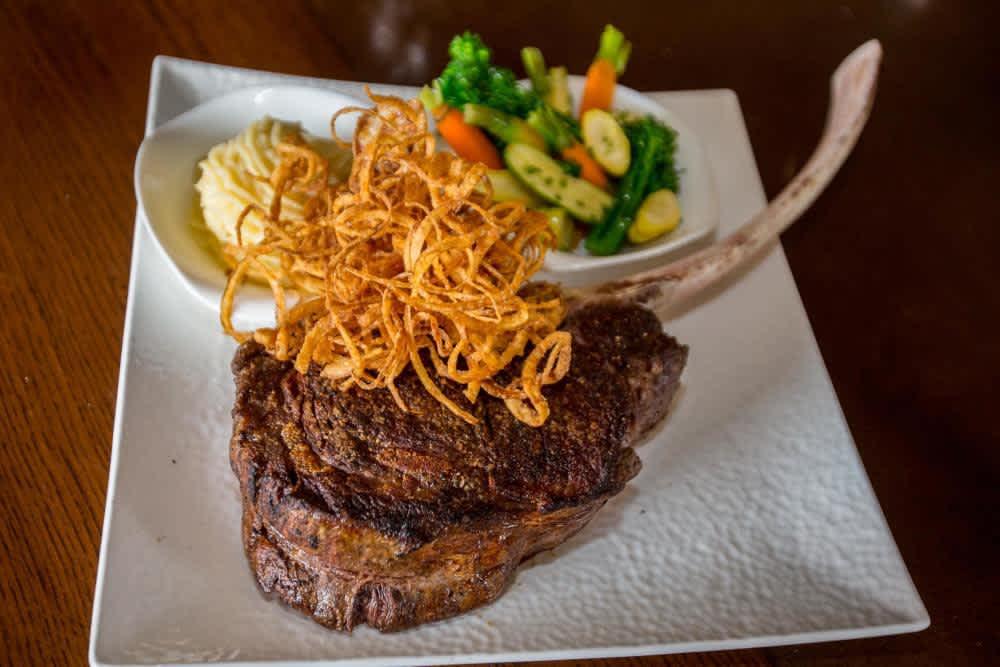 The Tomahawk Ribeye at Jimmy's, An American Restaurant & Bar