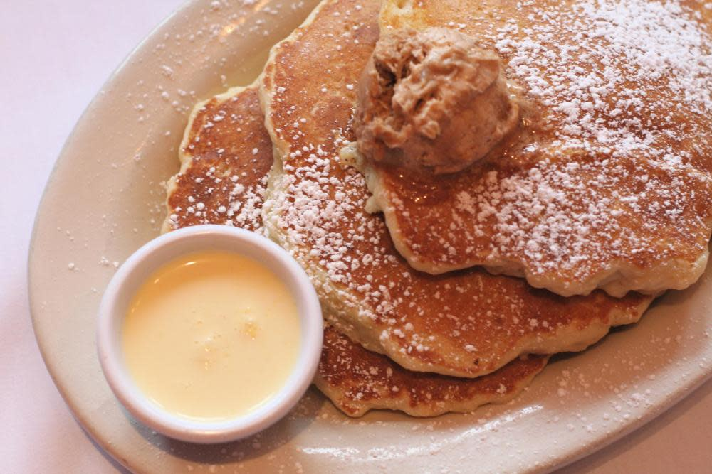 pancakes made of super gooey bread pudding with cinnamon-sugar butter & vanilla anglaise at Southport Grocery and Cafe