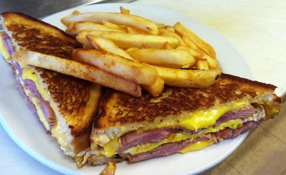 Grilled Ham and Cheese with an Egg Over Hard with Spice and Fries at Jodie's Restaurant