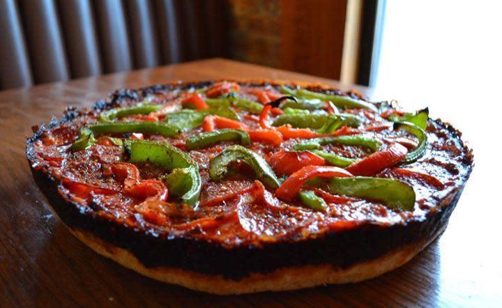Photo at Pequod's Pizzeria